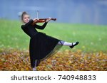 playing violin with fun | Shutterstock . vector #740948833