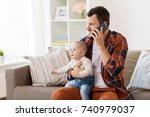 family  parenthood and people... | Shutterstock . vector #740979037