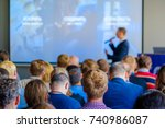 audience listens to the... | Shutterstock . vector #740986087