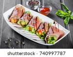 fried meat wrapped in a... | Shutterstock . vector #740997787