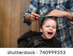 a little boy is trimmed in the... | Shutterstock . vector #740999353