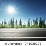 asphalt road in forest | Shutterstock . vector #741035173