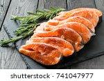 fresh salmon sliced on steaks...   Shutterstock . vector #741047977
