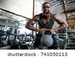 man shouts and screams pushing... | Shutterstock . vector #741050113