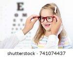 child at eye sight test. little ... | Shutterstock . vector #741074437