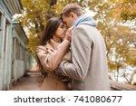 beautiful happy couple walking... | Shutterstock . vector #741080677