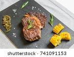 grilled rib eye beef steak meat ... | Shutterstock . vector #741091153