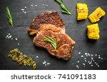 grilled rib eye beef steak meat ... | Shutterstock . vector #741091183
