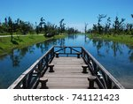 beautiful lake water and bridge | Shutterstock . vector #741121423