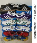 Small photo of London, England - May 08, 2017: Pairs of Adidas Trainers, Adidas is a German Sports manufacturer founded in 1924 - illustrative editorial