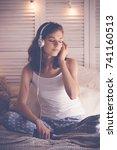 young  woman relaxing in her... | Shutterstock . vector #741160513