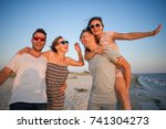 two young couples admire a... | Shutterstock . vector #741304273