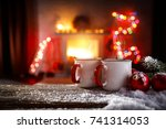 christmas time and mug on table ... | Shutterstock . vector #741314053