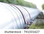 metal pipes on the street.... | Shutterstock . vector #741331627