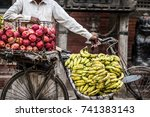 bananas and apples on a bike on ... | Shutterstock . vector #741383143
