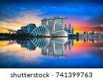 singapore city skyline at dusk | Shutterstock . vector #741399763