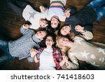 happy friends lying together in ... | Shutterstock . vector #741418603