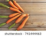 fresh young whole carrots on... | Shutterstock . vector #741444463
