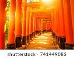 Stock photo thousands of vermilion torii gates of famous landmark fushimi inari taisha south of kyoto japan 741449083