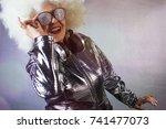 an amazing grandma dj  older... | Shutterstock . vector #741477073