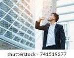 handsome and smart businessman... | Shutterstock . vector #741519277