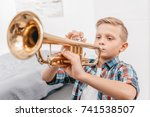 young boy practicing playing... | Shutterstock . vector #741538507