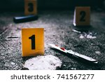 Evidence Markers With Knife An...