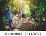 blurry people in volunteer... | Shutterstock . vector #741572473