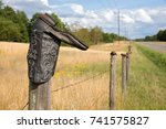 cowboy boot on a barbed wire... | Shutterstock . vector #741575827