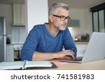 middle aged man working from... | Shutterstock . vector #741581983