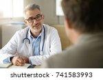 doctor talking to patient in... | Shutterstock . vector #741583993