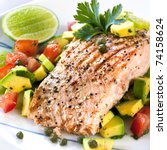 Grilled Atlantic salmon with an avocado and tomato salsa.  Delicious healthy eating. - stock photo