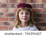 portrait of a beautiful little... | Shutterstock . vector #741591427