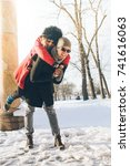 happy couple on winter vacation.... | Shutterstock . vector #741616063