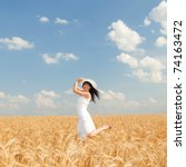 Cute Woman In Golden Wheat