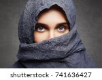 beautiful woman covers her face ... | Shutterstock . vector #741636427