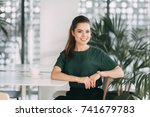 business girl with a mug of... | Shutterstock . vector #741679783