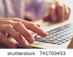 a closeup of an office worker... | Shutterstock . vector #741703453