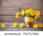 calendula flowers on dark old... | Shutterstock . vector #741717403