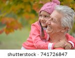 grandfather and granddaughter... | Shutterstock . vector #741726847