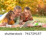 father with children using... | Shutterstock . vector #741729157