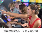 woman sitting at slot machine... | Shutterstock . vector #741752023
