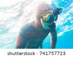 man in  neoprene suit with a... | Shutterstock . vector #741757723