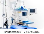 Small photo of Modern technological equipment in surgery room. Details of medical lifecare support equipment