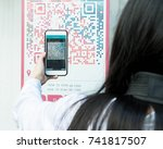 woman scan qr code with smart... | Shutterstock . vector #741817507