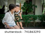 asia baby and mother  in the... | Shutterstock . vector #741863293