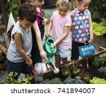 Group Of Kids Watering The...