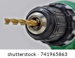drill with drill bit. focus is... | Shutterstock . vector #741965863