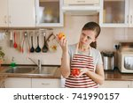 the young confused woman in an... | Shutterstock . vector #741990157