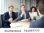 job interview with the employer ... | Shutterstock . vector #741997777